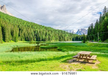 Wooden bench and table in picnic area, Italy