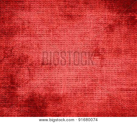 Grunge background of coral red burlap texture