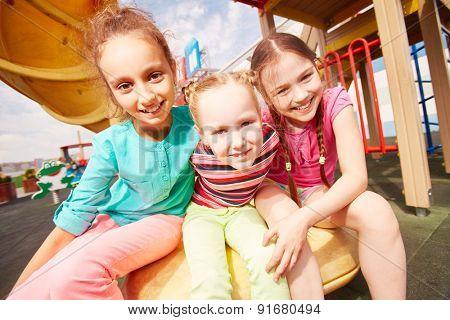 Active girls spending summer vacations outdoors