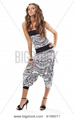 Young Pretty Lady In Harem Pants Full-length Studio Portrait On White