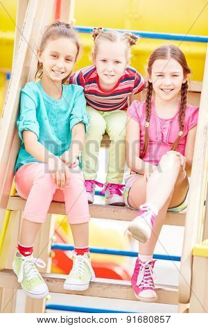 Active friends spending leisure on playground