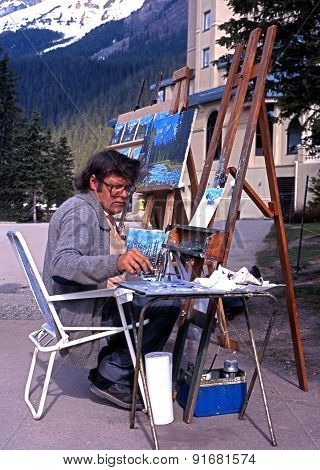 Artist on the edge of Lake Louise.