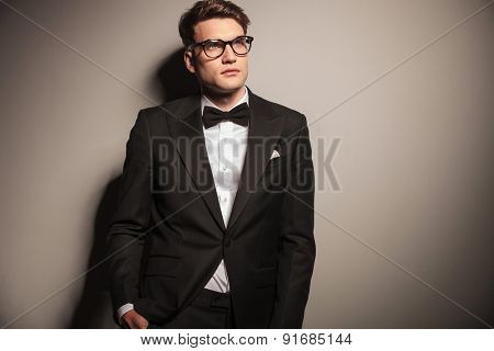 Picture of a handsome elegant business man looking up.