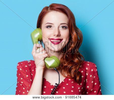 Girl In Red Dress With Green Dial Phone