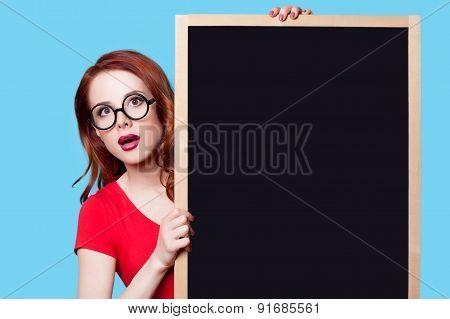 Girl In Red Dress With Blackboard