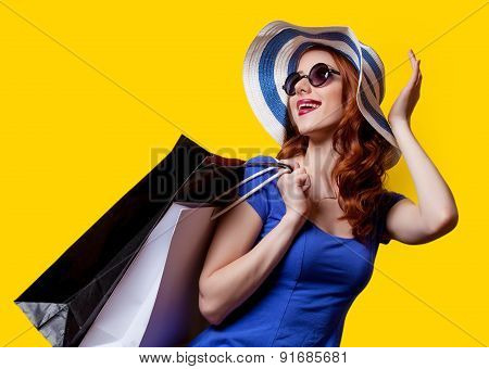 Girl In Blue Dress With Shopping Bags