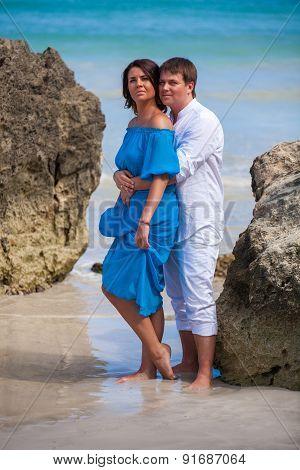 Beach couple walking on romantic travel.