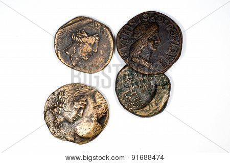 Vintage Bronze Coins With Portraits On A White Background