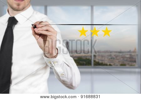 Businessman In Office Pushing Button Three Golden Rating Stars