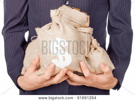 Hands Holding Bags With Coins