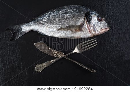 Fresh Whole Sea Fish With Knife And Fork,eating Concept