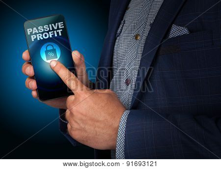 Businessman Presses A Button Touch Screen Passive Profit Smatrfona. Business, Technology, Internet A
