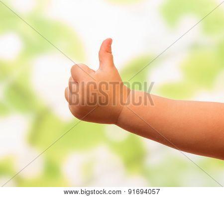 Child hand showing ok