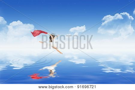 Dancing girl in white dress above water surface