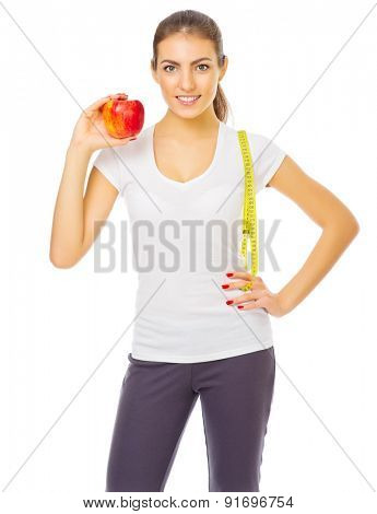 Young woman with apple isolated