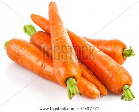 Fresh carrot with green leaves. Isolated on white background