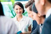 stock photo of southeast asian  - Business team meeting of Asian and Caucasian executives - JPG