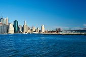 stock photo of brooklyn bridge  - Lower Manhattan skyline and Brooklyn bridge in New York City - JPG