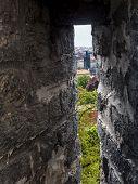 image of fortified wall  - Charles Bridge seen through fortified wall embrasure - JPG