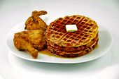 foto of fried chicken  - Fried chicken and waffles with maple syrup and butter on a white plate and shot on a white background