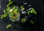 stock photo of mojito  - Glass of mojito with lime and mint top view selective focus - JPG