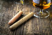 stock photo of cigar  - quality cigars and cognac on an old wooden table - JPG
