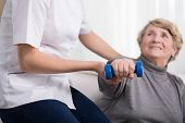 picture of physiotherapist  - Aged exercising woman and female physiotherapist