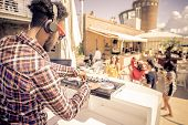 image of clubbing  - Dj playing trendy music in a open air club  - JPG