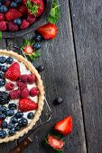 pic of tarts  - Homemade tart with fresh berries summer fruit on rustic table - JPG