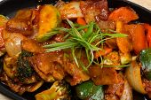 stock photo of pot roast  - Roasted meat with vegetables in a skillet - JPG