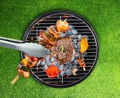 picture of barbecue grill  - Barbecue grill with various kinds of meat - JPG
