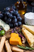 picture of cheese platter  - Cheese board with fresh grapesherbs and olives red wine - JPG