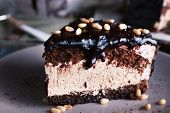 stock photo of icing  - Delicious chocolate cake with icing in plate on table - JPG