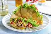 image of tacos  - Tasty taco on plate on table close up - JPG