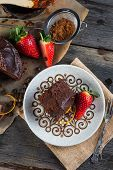 stock photo of tort  - overhead view on chocolate torte cake served on plate - JPG