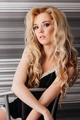 stock photo of red lingerie  - sexy blonde girl with long hair in black lingerie and red shoes - JPG