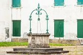stock photo of wishing-well  - Old water well over 100 years old - JPG