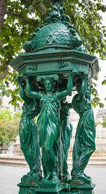 stock photo of bonaparte  - Outdoor fountain with women group sculpture near Saint - JPG
