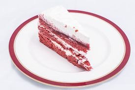 stock photo of red velvet cake  - Red velvet cake with its bright red color sharply contrasted by a white cream - JPG