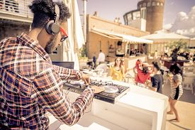 stock photo of disc jockey  - Dj playing trendy music in a open air club  - JPG