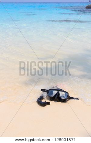 Diving mask and snorkel on the beach