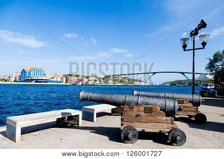An Old cannons on walkway in Curacao