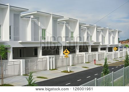MALACCA, MALAYSIA -JANUARY 25, 2016 Landed and identical new terrace house design in Seremban, Malaysia.