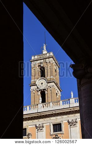 Clocktower from Capitoline Hill with Rome goddess statue at the top seen from square porch