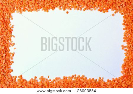 Frame From Red Lentils On The White Background