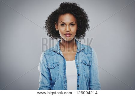Serious Black Woman With Blue Jean Shirt