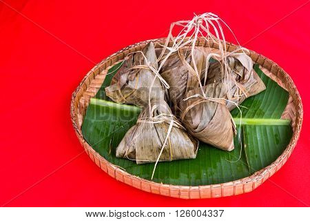 Bunch Of Chinese Rice Dumpling Placed On Traditional Rattan Tray