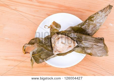 Freshly Prepared Chinese Rice Dumpling Or Zongzi Unwrapped On Plate