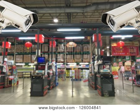The CCTV Security Camera operating in counter service cashier at supermarket store blur background, CCTV Camera concept, CCTV Camera background, CCTV Camera idea, CCTV Camera copy space, CCTV Camera video.