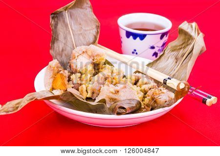 Steamed Chinese Rice Dumpling Or Zongzi Served With Oriental Tea